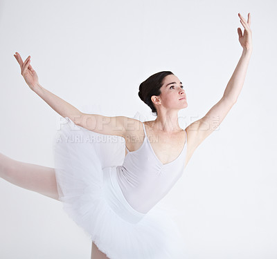 Buy stock photo Supple young ballerina dancing against a white background