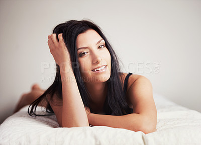 Buy stock photo Portrait of a sexy young brunette lying on her bed seductivley