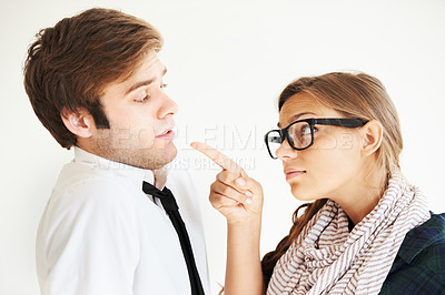 Buy stock photo A hipster woman pointing accusingly at her partner