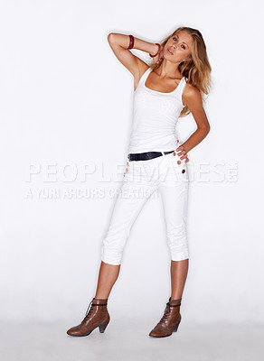 Buy stock photo Portrait of a trendy young woman standing on a white background