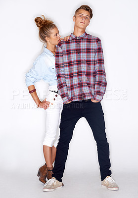 Buy stock photo Portrait of a funky young couple standing on a white background