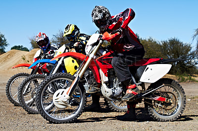 Buy stock photo Three bikers sitting on their motorcycles ready for a race