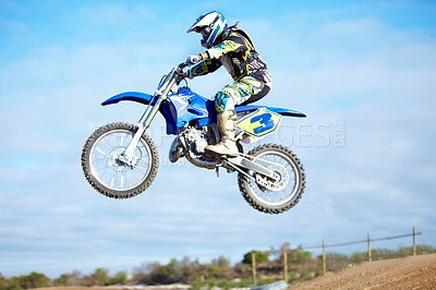 Buy stock photo A motocross rider in the air during a jump