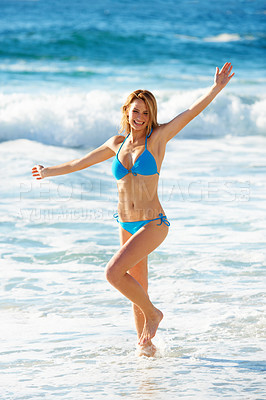 Buy stock photo Portrait of a gorgeous young woman dancing in the ocean