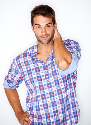 Buy stock photo Handsome young guy in a check shirt with his hand behind his head against a white background