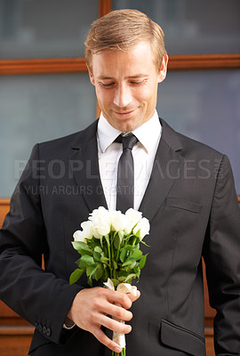 Buy stock photo Portrait of a handsome man holding a bunch of white roses and smiling