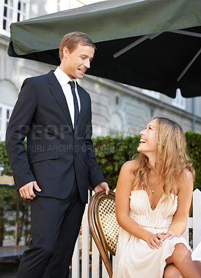Buy stock photo A gentleman seating his girlfriend at a restaurant