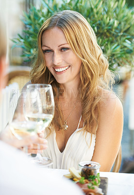 Buy stock photo A beautiful woman gives a toast in a restaurant