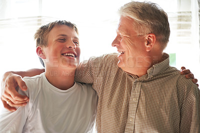 Buy stock photo Cropped shot of a senior man and his grandson
