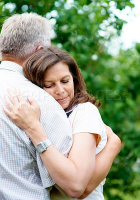 Buy stock photo Cropped shot of an affectionate senior couple embracing in the yard