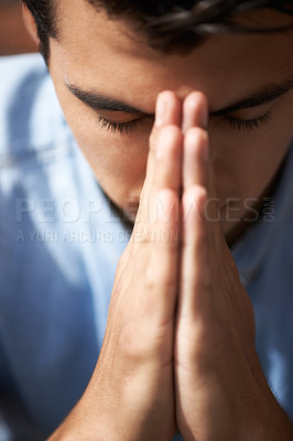 Buy stock photo Closeup of a young man praying with his hands together