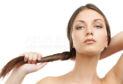 Buy stock photo A beautiful young woman tugging at her hair while isolated on a white background