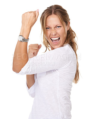 Buy stock photo A young woman doing a fist pump in an expression of victory