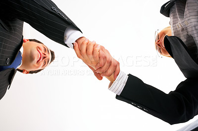Buy stock photo Teamwork and team spirit. Business handshake taken from below.