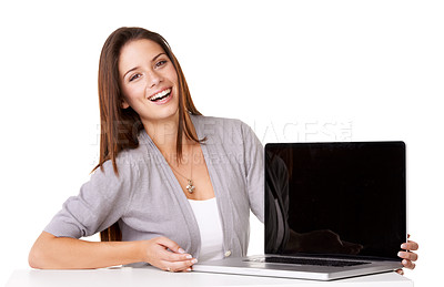 Buy stock photo A beautiful young woman holding her laptop with the screen on display