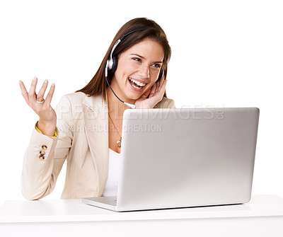 Buy stock photo Studio shot of a confident young woman using a laptop and headset against a white background