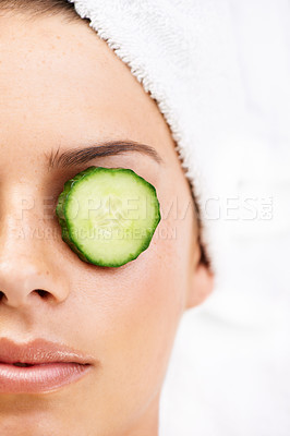 Buy stock photo Closeup shot of a young woman with cucumber slices on her eyes