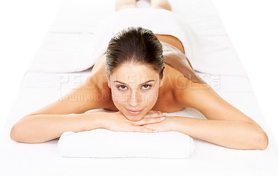 Buy stock photo Studio portrait of a young woman lying on a massage bed