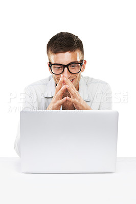 Buy stock photo A smiling male with hipster glasses looking at his Laptop