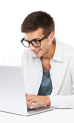 Buy stock photo A smiling male with hipster glasses typing on his Laptop