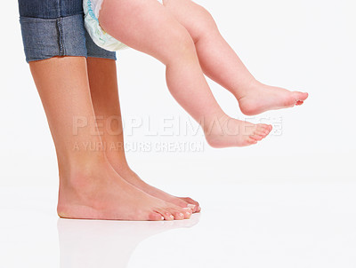 Buy stock photo Cropped close up shot of a mother teaching her baby how to walk