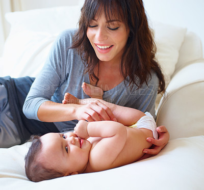 Buy stock photo Shot of a mother and her baby spending quality time together at home