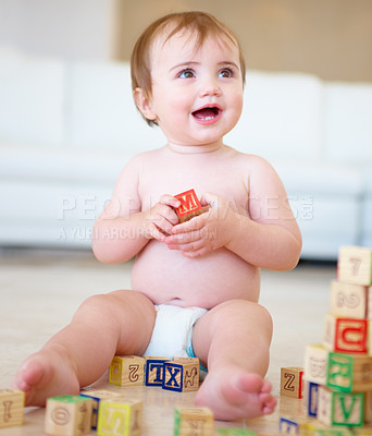 Buy stock photo Shot of a cute young baby playing with alphabet blocks