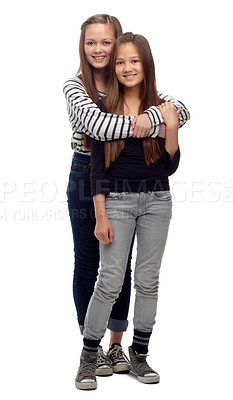 Buy stock photo Studio shot of a two teenage girls posing together against a white background
