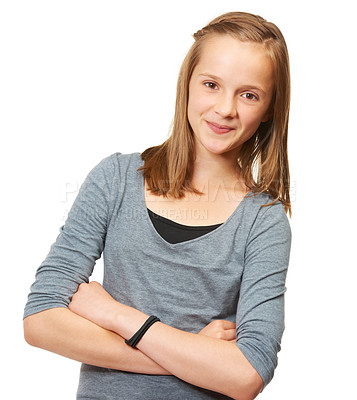 Buy stock photo Studio portrait of a young teenage girl standing against a white background