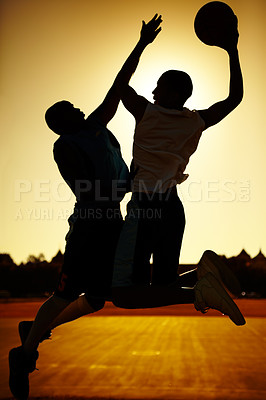 Buy stock photo The silhouettes of two basketball players