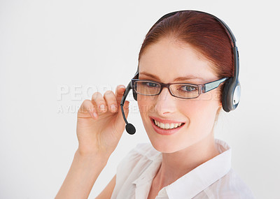 Buy stock photo A young telemarketer talking on her headset