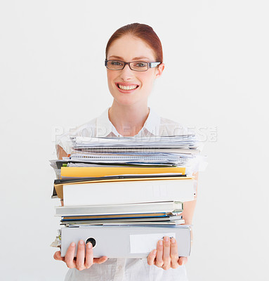 Buy stock photo A student carrying a pile of files and books