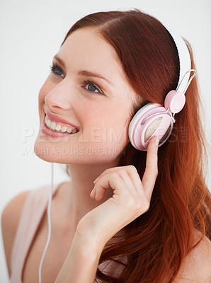 Buy stock photo Profile of a young woman listening to music