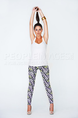 Buy stock photo Full length studio shot of an attractive young woman posing for the camera and pulling up her ponytail