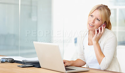 Buy stock photo A blonde businesswoman talking on the phone