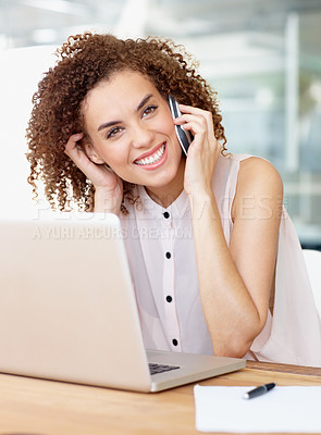 Buy stock photo A young businesswoman talking on her cellphone