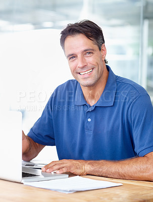 Buy stock photo A mature businessman in his office