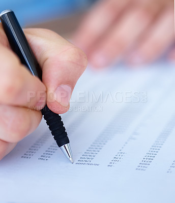 Buy stock photo Close-up of a male hand writing on a document