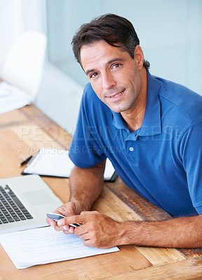 Buy stock photo A businessman holding his cellphone