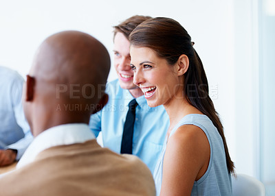 Buy stock photo A beautiful young businesswoman smiling and laughing while in a meeting