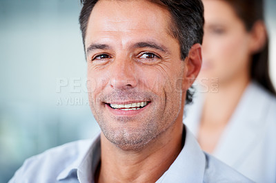 Buy stock photo A mature businessman smiling at the camera