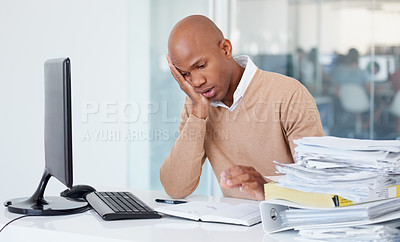 Buy stock photo A stressed out businessman grimacing