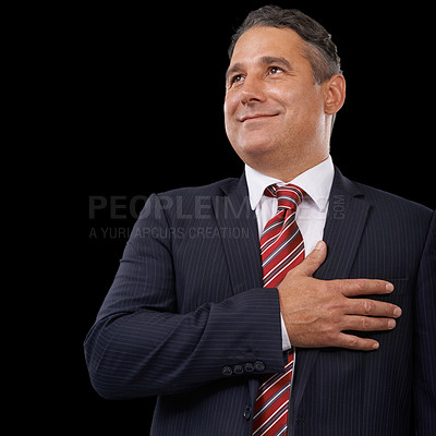 Buy stock photo A mature politician with his hand on his heart - black background