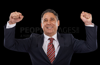 Buy stock photo A man in a suit with his arms raised in celebration -  black background