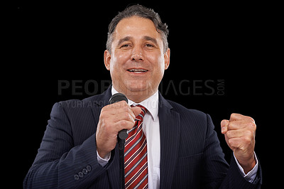 Buy stock photo A man in a suit giving a speech while holding a microphone