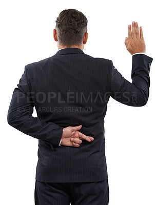 Buy stock photo Rearview of a mature man swearing an oath with his fingers crossed behind his back