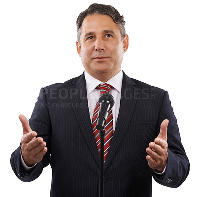 Buy stock photo A man in a suit with his hands raised while saying a speech into a microphone