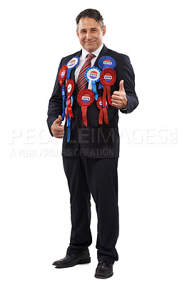 Buy stock photo Portrait of a friendly looking politician wearing voting ribbons and giving you the thumbs up
