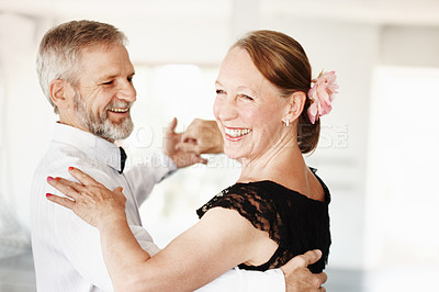 Buy stock photo Shot of a mature couple dancing together in formal attire