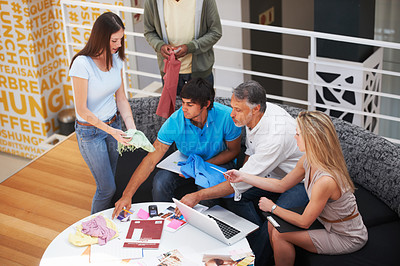 Buy stock photo A team of designers deciding on which material to use